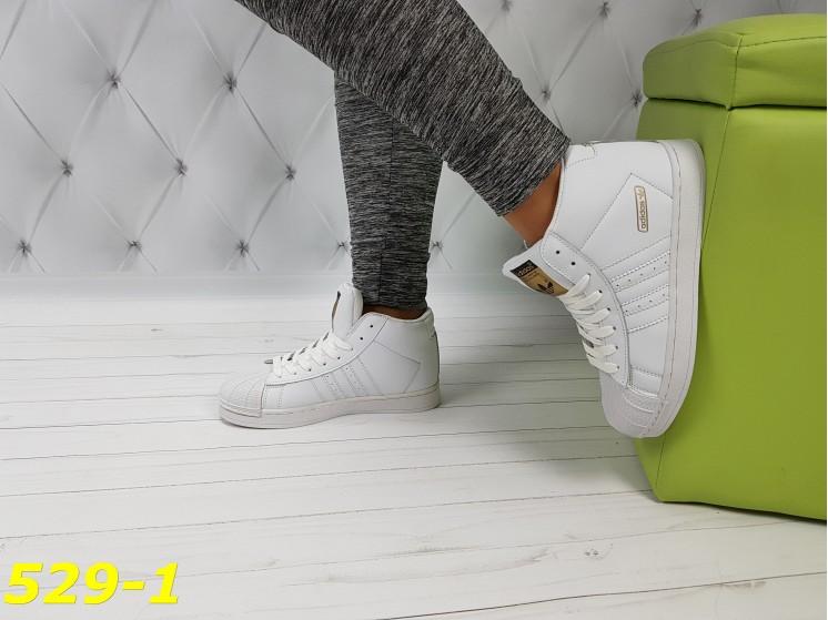 Кроссовки белые суперстар с брендовыми значками