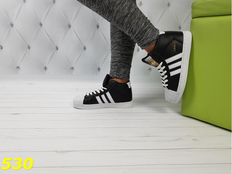Кроссовки суперстар чёрные с брендовыми значками